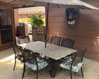 Stone top patio table w/6 chairs & umbrella