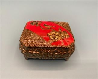 Gold filigree jewelry box with red velvet lining
