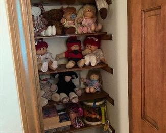 Closet full of stuffed animals of all brands Cabbage Patch dolls, puppets and games