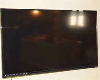 Three flat screen TVs