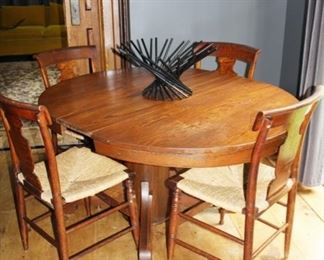 pedestal oak table, four matching chairs