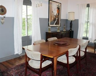 Mid century table with two leaves - perfect for entertaining. MCM dining chairs. Traditional buffet.