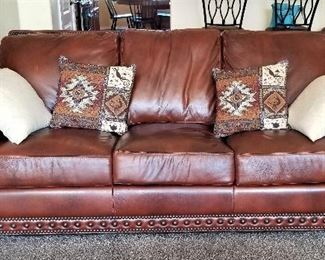 Leather sofa and southwest pillows