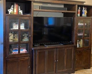 """This wall unit is from Haverty's. It will hold a flat screen TV up to 60"""". It has beautiful ambient lighting inside the cabinets."""