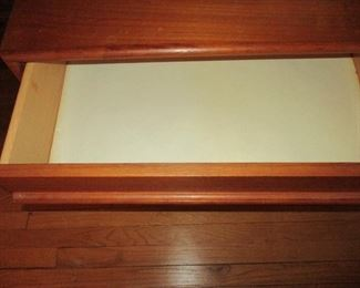 $1.200.00  MCM TEAK LOW BOY DRESSER WITH 9 DRAWERS, PRISTEEN CONDITION 75X24X18  SHOWING INSIDE OF ONE DRAWER