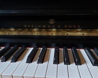 Steinway & Sons ebony upright piano, 1988