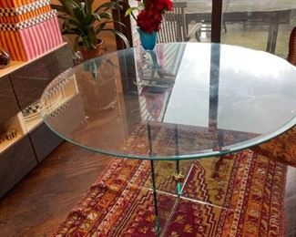Lovely heavy glass-topped table on a modern glass