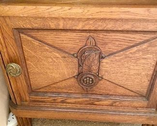 Additional photo of carving on bedside cabinet.