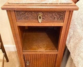 """Antique Marble Top Bedside Cabinet with Carved Top Drawer and Sliding Bottom Drawer. Brass Hardware. Measures 32"""" tall x 16"""" wide x 16"""" depth."""