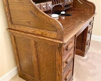 Additional photo of side view of roll top desk