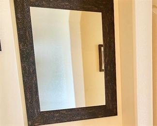 "Hammered Metal Framed Mirror. Measures 29"" wide x 35"" length."