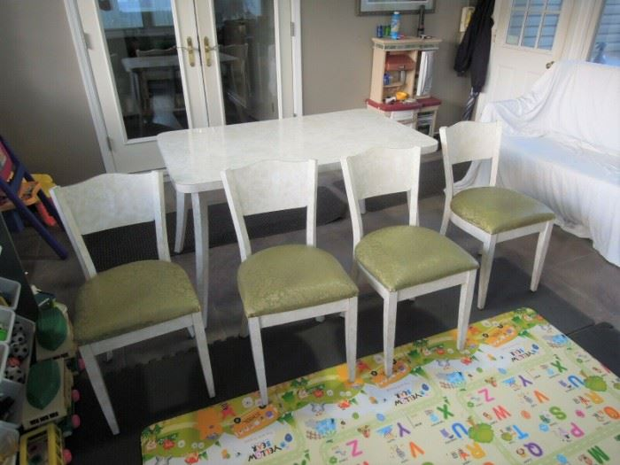 $400 obo -Very nice mid century modern formica kitchen table with center leaf and four chairs.  Table top , legs, chair backs and legs all covered in original formica. All pieces and cushions in very good to excellent original condition.