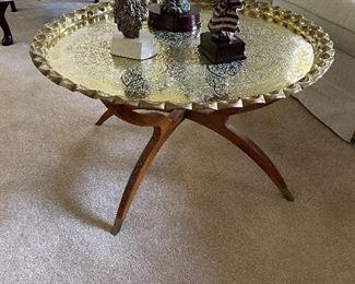 Vintage 1960's mid century Brass and teak coffee or tea table.  Base has carved hinged leg