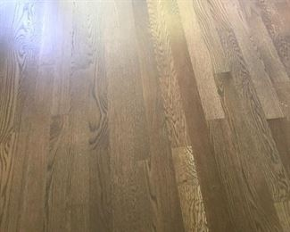 """Oak hardwood floors installed in 2020 in color """"griege"""" priced at .65 per square foot"""