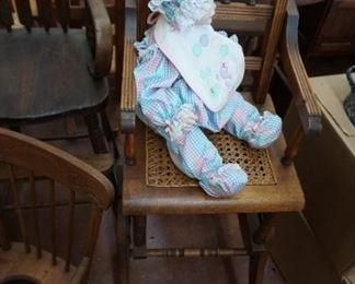 doll and antique high chair