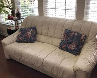 Leather couch. Part of a set. Lightly used and very comfortable.