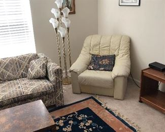 Lamp and white leather chair, part of a set