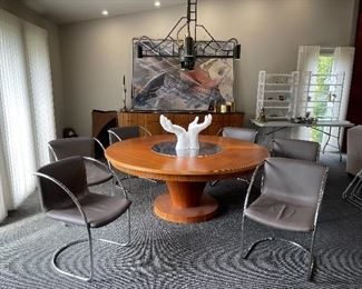 CUSTOM DINING TABLE WITH CHROME LAZY  SUSAN CENTER AND ITALIAN LEATHER CHAIRS