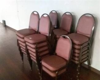 32 Red cushioned chairs with brown metal legs