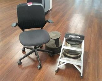 Black office chair with 2 wheeled steps and a step ladder
