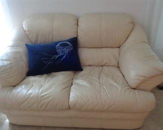 "Italian leather love seat white-cream colored, 64"" long"