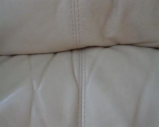 detail of Italian leather sofa and love seat