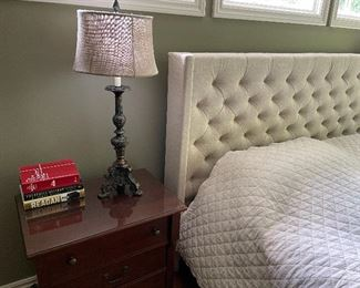 """King-sized bed with tall linen headboard (52.5"""" x 87"""" x 84"""") $650, King mattress set (Laura Ashley) $500, solid cherry nightstands (2) with drawer and glass on top (27.5"""" x 25.5"""" x 18"""") $375 for set, lamps $200 for set of 2"""