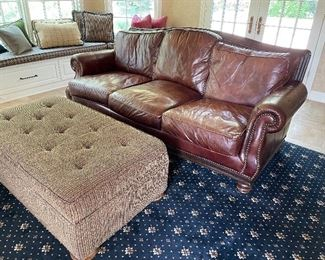 "Leather sofa by Henredon with nailhead detail:  (39' x 96"" x 47"") $800, ottoman (18"" x 53"" x 30"") $150, Area rug (10' x 12') $250"