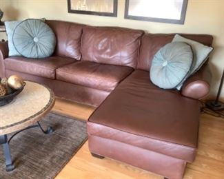 """Arhaus brown leather sectional.  Measures 104"""" long. Just Loveseat is 73"""" long and 35"""" deep.  Chaise is 69"""" deep.  Sectional is 32"""" high.  Presale $350 after Sept 9"""