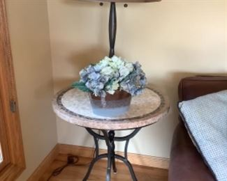 """Arhaus side table with tiled top and wrought iron legs. Measures 28"""" round and 29"""" h.  Presale $115 after sept. 9"""