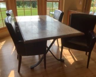 """Arhaus dining table with six chairs. Four arm chairs and two side in brown leather.   Measures 72"""" long and 40"""" wide.  Has tiled top. Chairs are showing wear.  Presale $250 after Sept. 9"""
