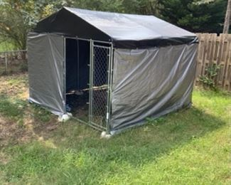 Outdoor Dog Galvanized Kennel 10 x 16, currently covered used as an outdoor storage for lawn mowers and garden tools.