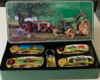 Series of Tractor Knives with key Chain in original matching tin.