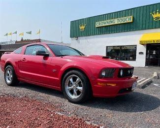 2008 Red Mustang GT.  Starting bid: $10500