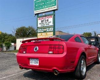 2008 Red Mustang GT.  Starting bid: $10,500