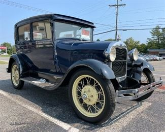 1929 Blue Ford Model A with Soft Top.  Starting Bid: $15,500.00