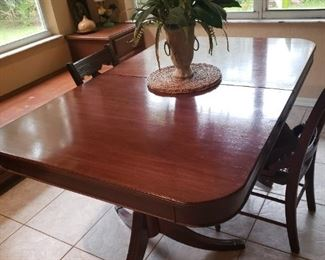 Cherry finish wooden dining room table, there are no chairs
