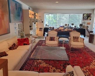 Persian hand knotted Heriz carpet, Mies van der Rohe style Barcelona table, mid-century sectional