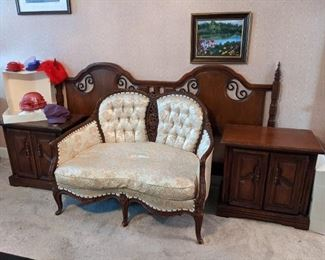 Antique loveseat amidst a King bedroom suite