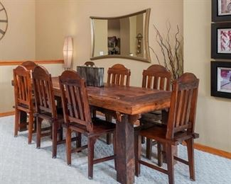 This table is made of teakwood. The top of the table is made from a castle door. THIS TABLE AND CHAIRS IS STURDY, HEAVY, WELL BUILT, AND JUST GORGEOUS!!
