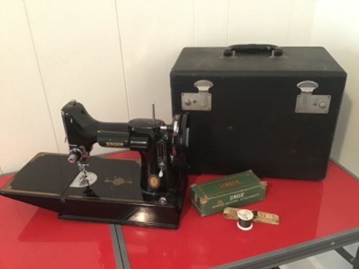 Singer featherweight sewing machine with Case, booklet, and attachments