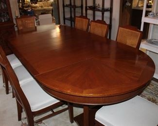 """8 and 1/2' long and 48"""" wide, as shown, solid wood, excellent condition. Shown with three 18"""" leaves; 48"""" round without the leaves. Ten chairs, two armchairs and 8 sidecars"""
