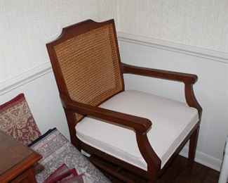 one of two armchairs with the dining table