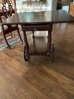 Antique serving cart with drop leaf sides and drawer