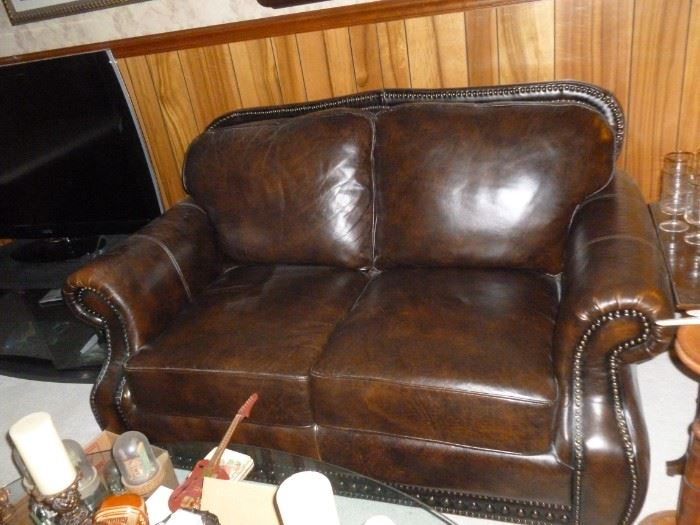 Awesome leather loveseat w/tack trim