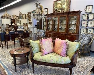 Set of six Theodore Alexander dining chairs  Chippendale style breakfront Federal Style Bird Cage Pedestal Round Dining Table.  Caned back salon settee with silk cushion Pair of Marge Carson easy chairs Antique tilt top table