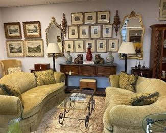 Pair of kidney shape sofas upholstered in chenille fabric. Beautiful brass and iron cocktail table. Multiple antique prints, Stunning mirrors, Pair of chinoiserie floor lamps.