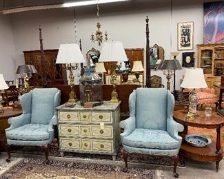 Pair of antique wingback chairs, Antique polychromed chest, pair of oval end tables, pair of brass lamps, pair of Chinese lamps.