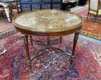 Maitland-Smith parcel gilt marble top foyer table with brass gallery on turned and tapered fluted legs.