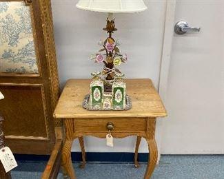 Rustic pine side table on cabriole legs, Italian enamel floral lamp.